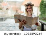 happy blond female traveling... | Shutterstock . vector #1038893269