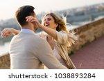 happy couple in love hugging... | Shutterstock . vector #1038893284