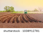 spring sowing. tractor in the... | Shutterstock . vector #1038912781
