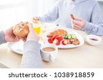 family eating breakfast at home | Shutterstock . vector #1038918859