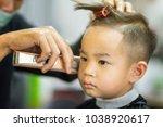 hairdresser's hands making... | Shutterstock . vector #1038920617