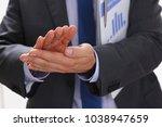 the businessman applauds at a... | Shutterstock . vector #1038947659