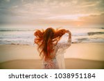 Young Red Haired Woman With...