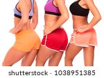 three fit girls posing against... | Shutterstock . vector #1038951385