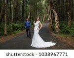 walking the young bride and... | Shutterstock . vector #1038967771