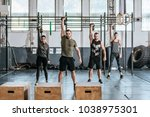 group of people lifting weights ...   Shutterstock . vector #1038975301
