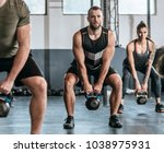 group of men and women lifting... | Shutterstock . vector #1038975931