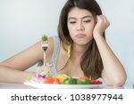 unhappy asian women is on...   Shutterstock . vector #1038977944