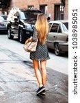 lone woman on a backstreet ... | Shutterstock . vector #1038985051
