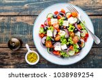 greek salad of fresh cucumber ... | Shutterstock . vector #1038989254