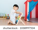 asian baby boy learns to count. ...   Shutterstock . vector #1038997534