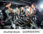 group of sporty women and men... | Shutterstock . vector #1039005595