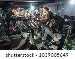 sporty people riding indoor... | Shutterstock . vector #1039005649