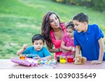 brothers coloring easter eggs | Shutterstock . vector #1039035649
