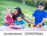 brothers coloring easter eggs | Shutterstock . vector #1039035661