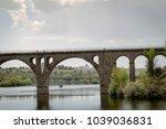 old stone bridge for railroad... | Shutterstock . vector #1039036831