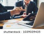 asian business adviser meeting... | Shutterstock . vector #1039039435