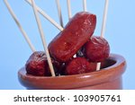 some red fried spanish chorizos served as tapas - stock photo