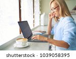 beautiful young freelancer in... | Shutterstock . vector #1039058395