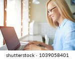 business woman typing on the... | Shutterstock . vector #1039058401