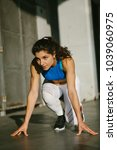 focused female athlete getting... | Shutterstock . vector #1039060975