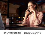 young  businesswoman in glasses ... | Shutterstock . vector #1039061449