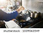 chef in restaurant kitchen... | Shutterstock . vector #1039063549