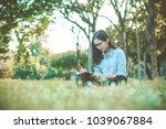 beautiful woman writing into... | Shutterstock . vector #1039067884