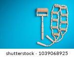 wooden massager on blue...   Shutterstock . vector #1039068925