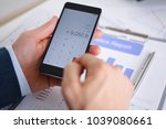 smartphone calculator and... | Shutterstock . vector #1039080661