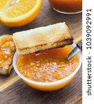 orange jam in bowl with toast...   Shutterstock . vector #1039092991