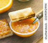 orange jam in bowl with toast...   Shutterstock . vector #1039092994