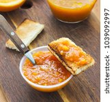 orange jam in bowl with toast...   Shutterstock . vector #1039092997