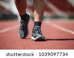 young asian man doing exercise... | Shutterstock . vector #1039097734