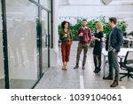 group of coworkers having a... | Shutterstock . vector #1039104061