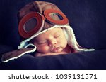 sweet little baby dreaming of... | Shutterstock . vector #1039131571
