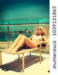 beautiful young woman relaxing... | Shutterstock . vector #1039131865