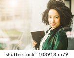 stylish young latin brazilian...   Shutterstock . vector #1039135579