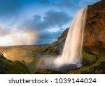 seljalandsfoss waterfall during ... | Shutterstock . vector #1039144024