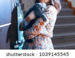 girl with a cat in her arms ... | Shutterstock . vector #1039145545
