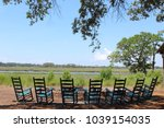 rocking chairs around a bonfire ... | Shutterstock . vector #1039154035