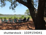 rocking chairs around a bonfire ... | Shutterstock . vector #1039154041