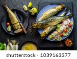 Stock photo mediterranean food smoked herring fish served with green onion lemon cherry tomatoes spices bread 1039163377