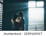 silhouette of lovers standing... | Shutterstock . vector #1039165417