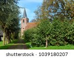 church with church path in the... | Shutterstock . vector #1039180207