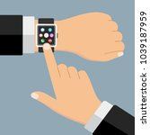 smart clock on a hand on a gray ...   Shutterstock .eps vector #1039187959
