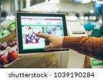 man weigh fruits on digital... | Shutterstock . vector #1039190284