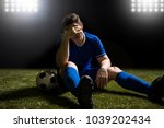 disappointed soccer player in... | Shutterstock . vector #1039202434