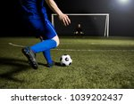 legs of a soccer player about... | Shutterstock . vector #1039202437