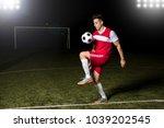 male footballer playing... | Shutterstock . vector #1039202545